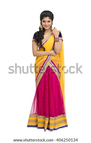 Happy beautiful Indian young girl in half sari over white background. - stock photo