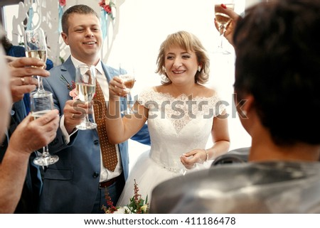 Happy beautiful newlyweds in restaurant