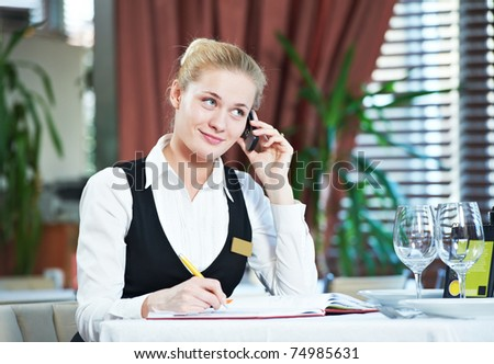 Happy beautiful restaurant manager woman administrator at work place