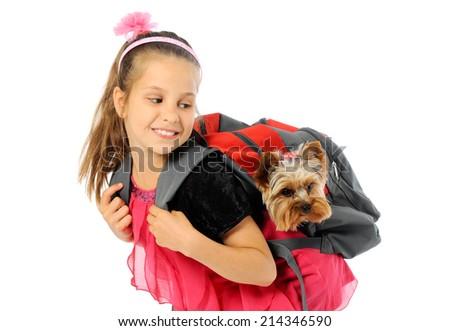Happy beautiful schoolgirl going to school with puppy - stock photo