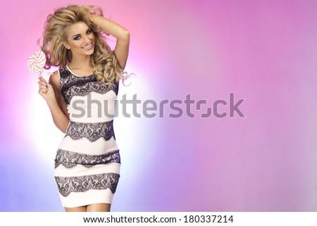 Happy beautiful smiling blonde woman posing in studio - stock photo
