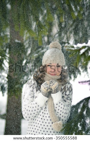 Happy,beautiful,smiling,cute,young,attractive,pretty girl,woman,female,adult,model,lady in white,winter,frozen,snowy forest,snowflakes,spruce,portrait,nature,beauty,smile,face,cold,snow,close-up,ice - stock photo