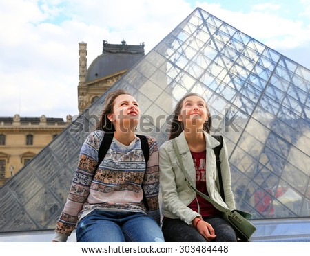 Happy beautiful student girls in the Louvre, Paris - stock photo