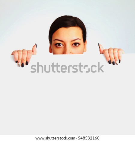 Happy beautiful woman holding blank white poster billboard