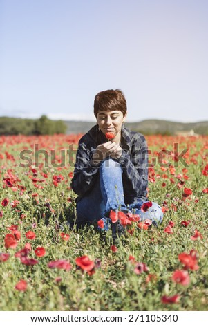 Happy beautiful woman in meadow. Freedom concept background - stock photo