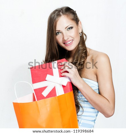 happy beautiful woman in  with shopping bags , christmas shopping , christmas gifts , sales - stock photo