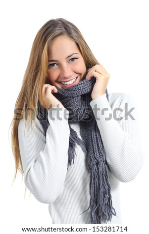 Happy beautiful woman keeping warm in a sweater in a cold winter isolated on a white background               - stock photo
