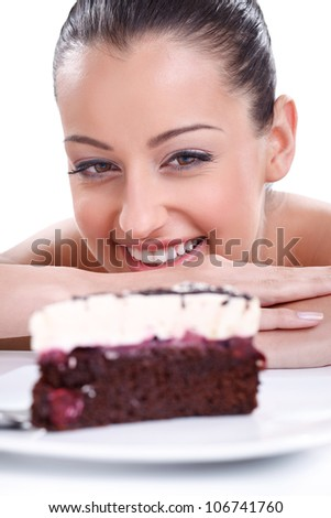 Happy beautiful woman looking in piece of tasty cakes - stock photo