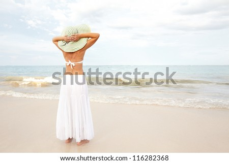 Happy beautiful woman on the beach. Vacation. - stock photo