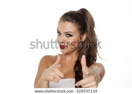 happy beautiful woman pointing fingers at you - stock photo