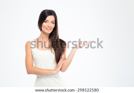 Happy beautiful woman presenting copyspace on the palm isolated on a white background - stock photo