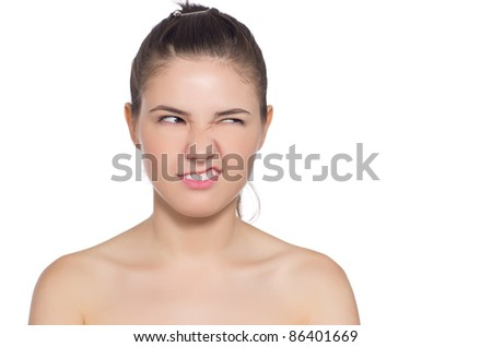 Happy beautiful woman's face with fresh clean skin. Isolated on white background
