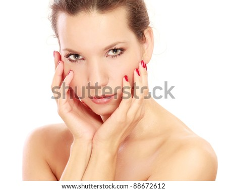 happy beautiful woman touching face and looking at camera isolated on white background