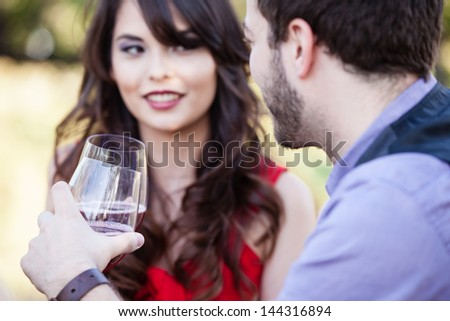 Happy Beautiful Young Couple toasting looking into each others eyes