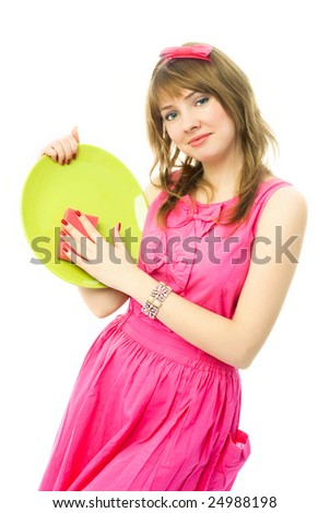 happy beautiful young housewife washing the dishes with a sponge