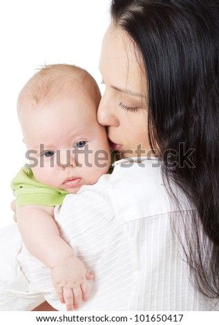 happy beautiful young mother holding her smiling little baby isolated on white background in studio