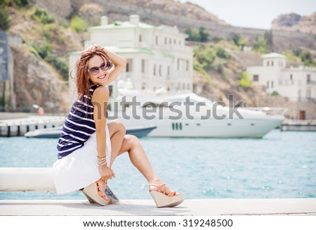 Happy beautiful young woman at the sea - stock photo