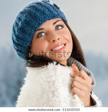 Happy beautiful young woman in warm soft clothes outdoor in a winter day - stock photo