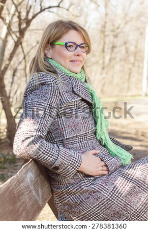 Happy Beautiful Young Woman Relax in Nature. Caucasian female autumn winter season clothing outdoor. - stock photo