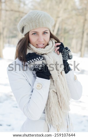 Happy Beautiful Young Woman Winter Saeson in the park. Caucasian female wintertime portrait outdoor. - stock photo