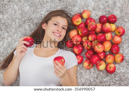 Happy Beautiful Young Woman, with group healthy organic red apples, brunette female at home