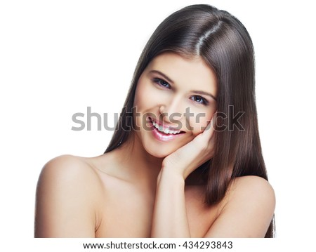 happy beautiful young woman with long healthy hair, isolated against white studio background