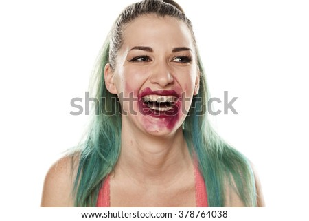 Happy beautiful young woman with smeared lipstick