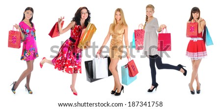 Happy  beautiful young women in a full-length with shopping bags. Isolated on white background - stock photo