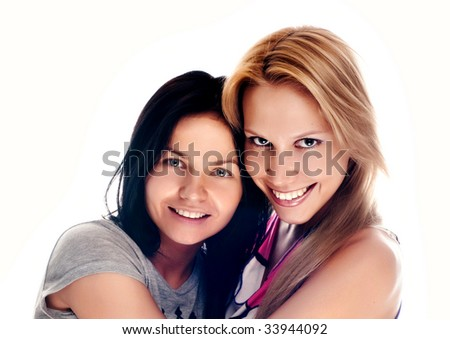 Happy beautiful young women laughing and hugging