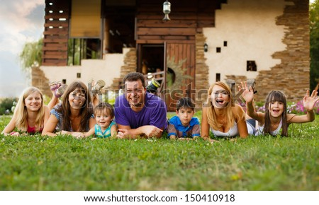 happy big family in the garden - stock photo