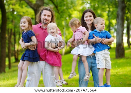 Happy big family of six having fun at summer park on beautiful sunny day - stock photo