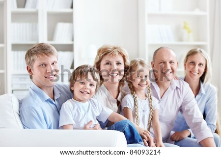 Happy big family with children at home - stock photo