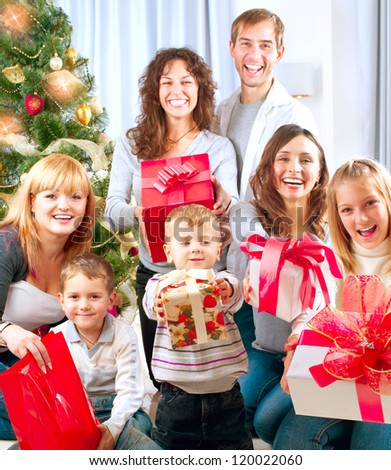 Happy Big family with Christmas presents at home.Christmas tree. New Year Gifts - stock photo