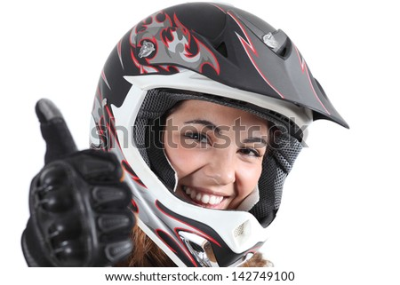 Happy biker woman with a motocross helmet and thumb up isolated on a white background - stock photo
