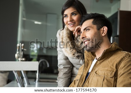 happy biracial couple relaxing in the lounge - stock photo
