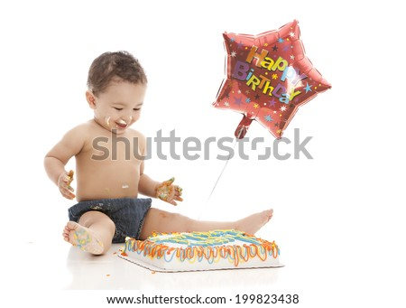 Happy Birthday!  Adorable boy eating a birthday cake.  Isolated on white with room for your text. - stock photo
