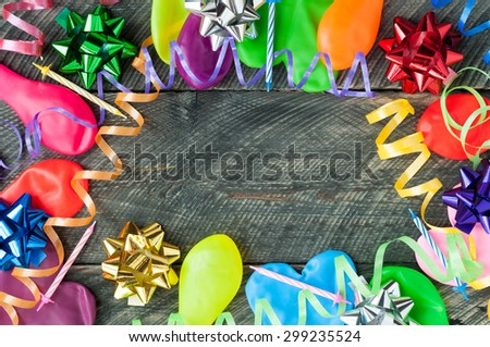 Happy birthday backgrounds. Balloons, streamers, ribbons, bows and candles on wooden table - stock photo