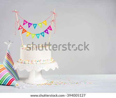 Happy Birthday cake and party hats