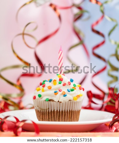Happy birthday candles cupcake - stock photo