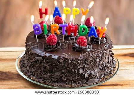 Birthday Cakes Images To Write Name ~ Happy birthday candles on chocolate cake stock photo royalty free