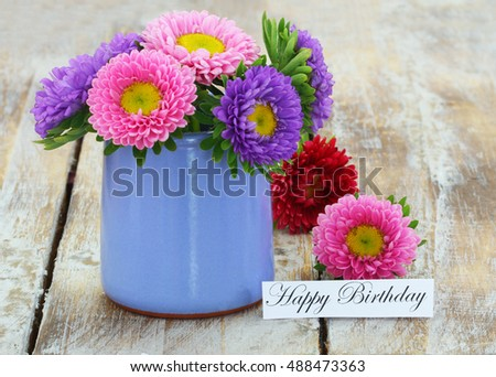 Happy Birthday Card With Colorful Daisy Flowers In Blue Pot On Rustic Wooden Surface