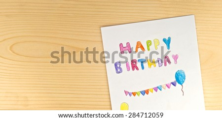 Happy birthday card kid handwriting on stock photo royalty free happy birthday card with kid handwriting on wood background top view bookmarktalkfo Choice Image