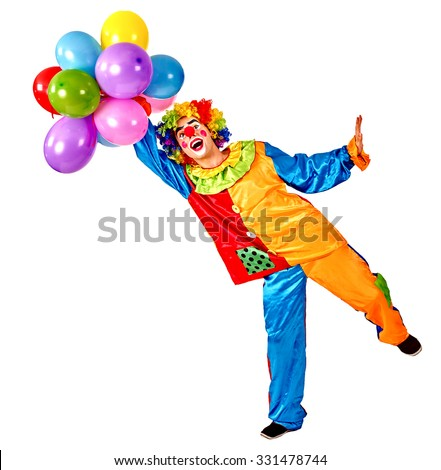 Happy birthday clown holding a bunch of balloons.  Isolated. - stock photo