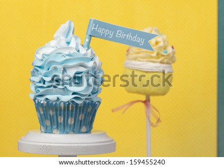 Happy Birthday cupcake with cakepop - stock photo