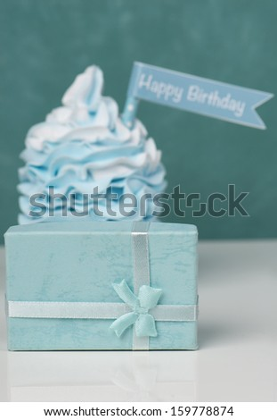 Happy birthday cupcake with present and flag with text - stock photo