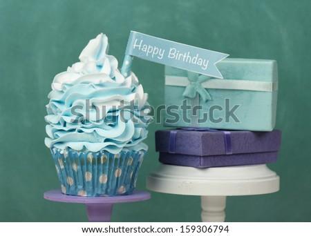 Happy Birthday cupcake with presents - stock photo