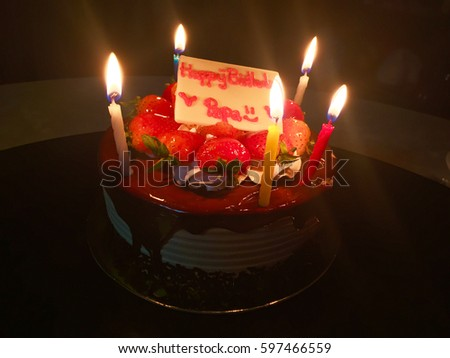 Happy Birthday Dad. Strawberry Cake With Candle Light In The Dark.