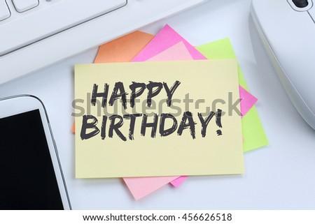 Happy Birthday greetings celebration desk computer keyboard - stock photo
