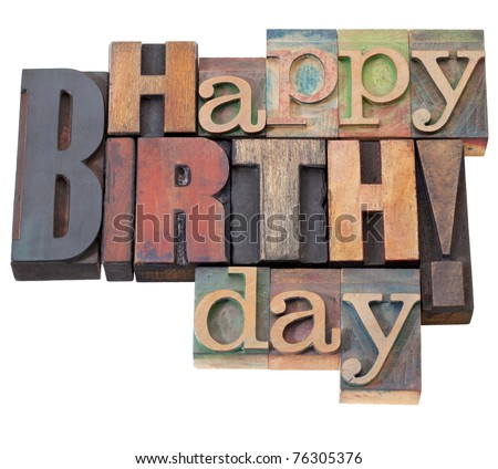 Happy Birthday in antique wood letterpress printing blocks, isolated on white - stock photo