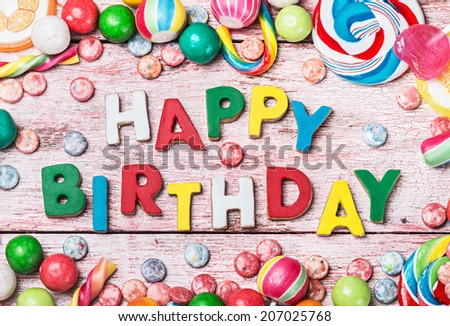 happy birthday letters from biscuits and sweets - stock photo